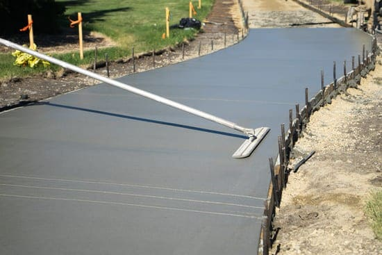 Large flattener smoothing out concrete paving.