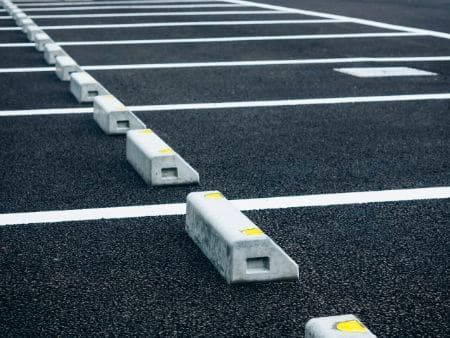 A parking lot that has just been sealed following the 6 steps you need to take to seal a parking lot